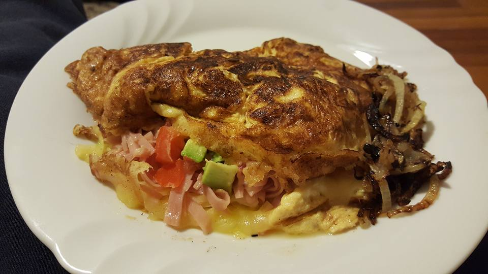 Omelette with ham cheese and tomato